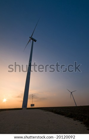 wind turbine silhouettes at dusk