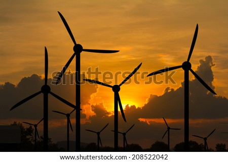 wind turbine sunset background - stock photo