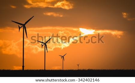 wind turbine sunset background ecosystem - stock photo