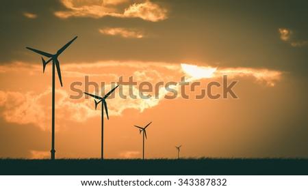 wind turbine sunset background ecosystem , vintage - stock photo