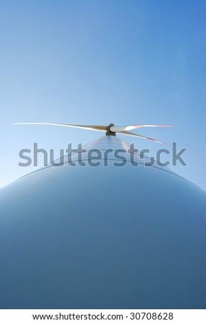 wind turbine under blue sky for alternative energy - stock photo