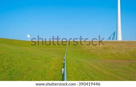 Wind turbine under construction along a lake - stock photo