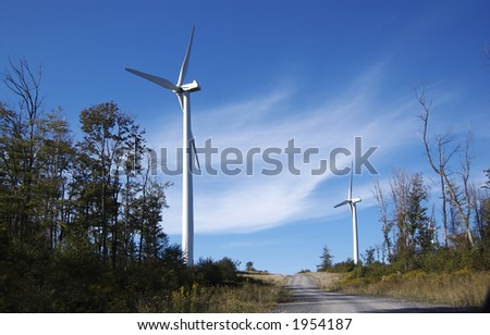 Wind turbine with a beautiful blue sky backdrop - stock photo