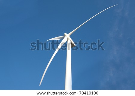 Wind Turbine with blue sky and clouds
