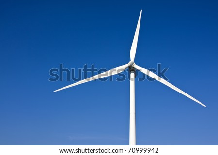 wind turbine with blue sky as background - stock photo