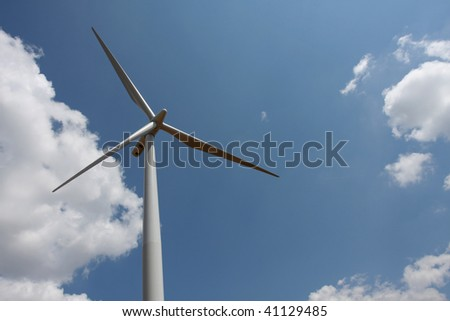 Wind turbine with cloudy sky