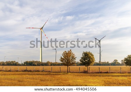 Wind turbine yellow field nature concept