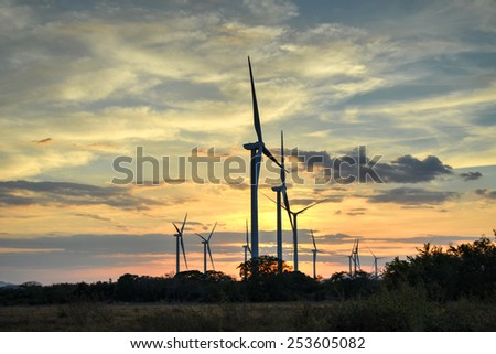 Wind turbines   against a beautiful sunset  in the central lowlands of Panama