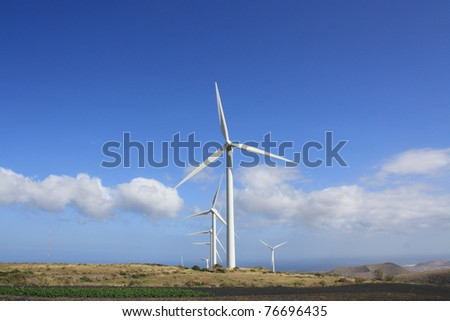 Wind Turbines against a blue sky with some white clouds (Lanzarote Canary Islands) - stock photo
