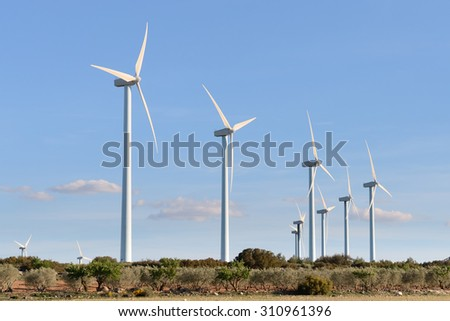 wind turbines against the blue sky - stock photo
