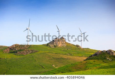 Wind turbines against the blue sky in the Sicily countryside