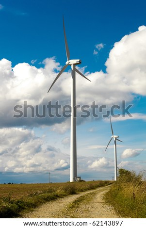Wind Turbines - alternative and green energy source in sunny daby with blue sky - stock photo