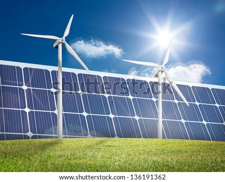 Wind turbines and solar panels in a green field