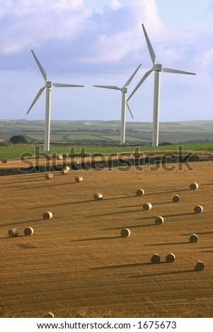 Wind turbines and straw bails - stock photo