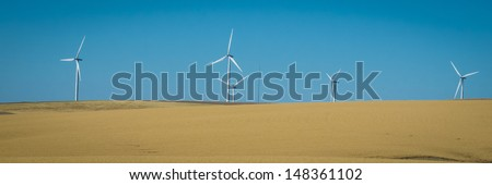 Wind turbines and wheat fields in eastern Washington state - stock photo