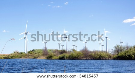Wind turbines at lake