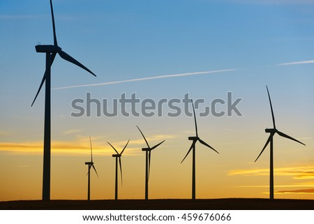 Wind turbines at sunset. Clean alternative renewable energy. Horizontal