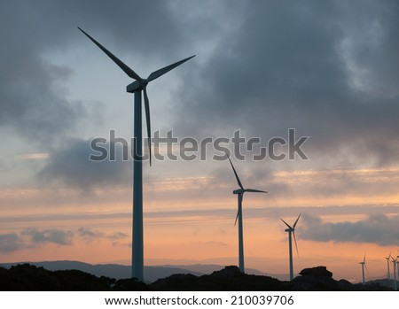 Wind turbines at sunset in a galician landscape.