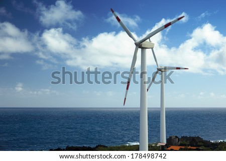 Wind turbines at the sea - stock photo