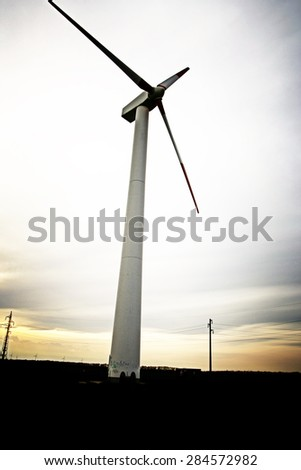 Wind turbines at the sunset. - stock photo