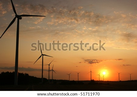 Wind turbines during sunset - stock photo