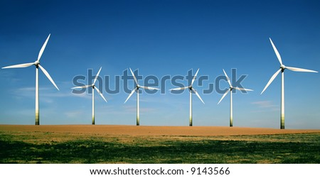 Wind turbines farm. Alternative energy source. - stock photo
