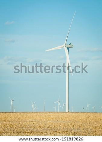Wind turbines farm at sunset in Limon, Colorado. - stock photo