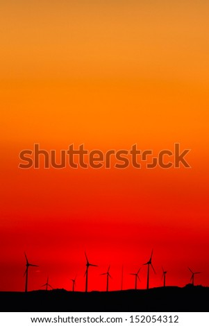 Wind turbines farm at sunset in southern Spain. - stock photo