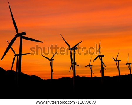 Wind turbines farm in sunset, clean energy.