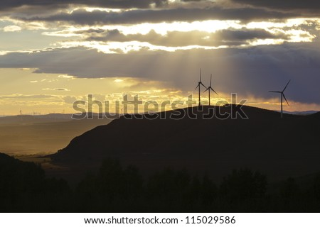 Wind turbines farm in the northeast of china - stock photo