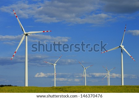 Wind turbines farm. Windmill