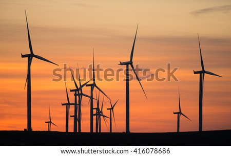 Wind Turbines High Hill Green Energy Generate Power Sunset - stock photo