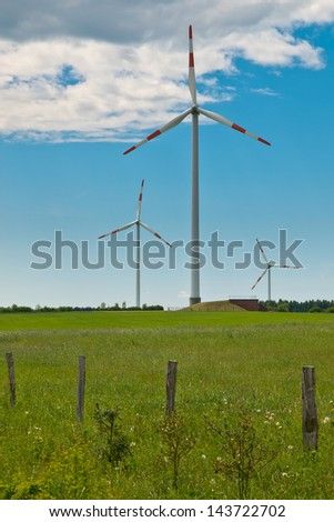 Wind Turbines in a Wind farm on top of a Hill in Germany