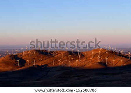Wind Turbines in Altamont Pass Wind Farm at Sunset, California. - stock photo