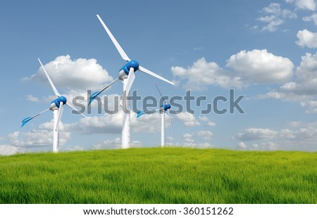 Wind turbines in an open field on cloudy day  - stock photo
