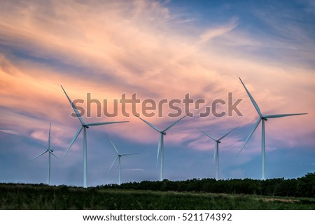 Wind turbines in beautiful sunset. Concept of clean, renewable, sustainable, alternative energy.