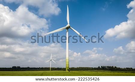 Wind turbines in Dutch landscape  - stock photo