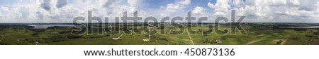 wind turbines in  fields under blue sky panorama - stock photo