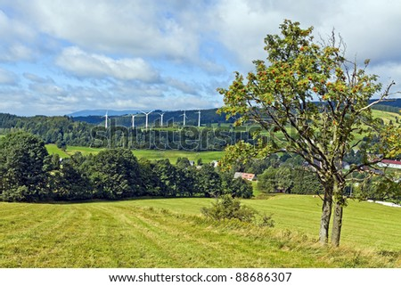 Wind turbines in mountains landscape - stock photo