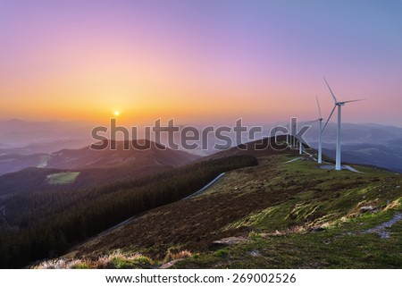 wind turbines in Oiz eolic park at sunset - stock photo