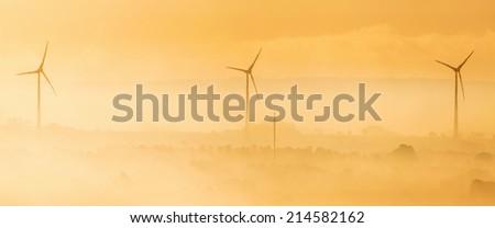 Wind turbines in the dawn light - stock photo