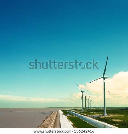 Wind turbines in the field generating electricity - stock photo