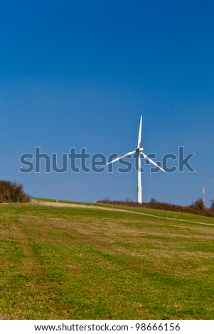 Wind turbines installations in the countryside for green energy