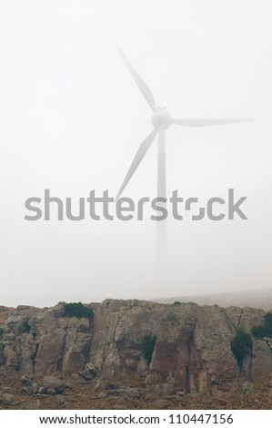 Wind Turbines on a misty day - stock photo