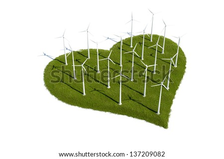 Wind turbines on a patch of heart shaped grass - stock photo