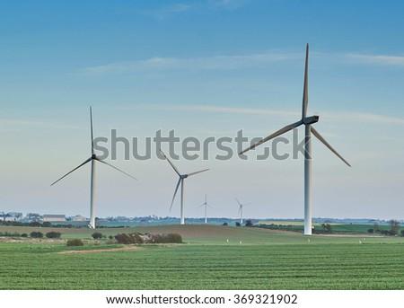 Wind Turbines on Farmland, Holderness, Yorkshire - stock photo