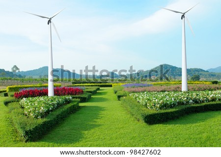 wind turbines on garden flower with blue sky - stock photo