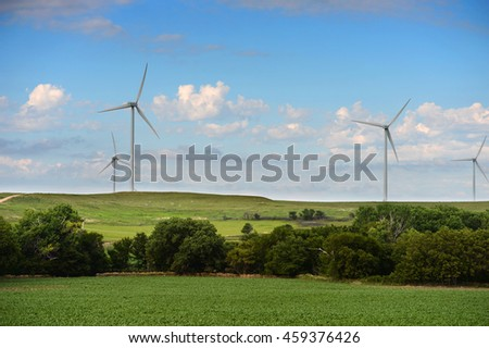 Wind turbines on hills during clear day