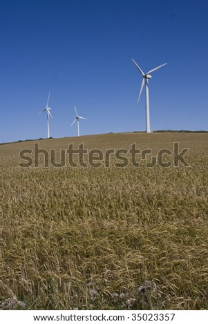 Wind turbines on hills on the Isle of Anglesey North Wales - stock photo