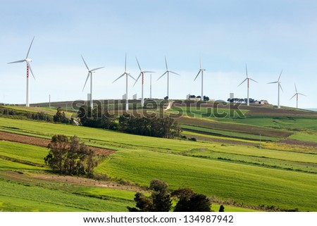 Wind turbines on hilly expanse - stock photo